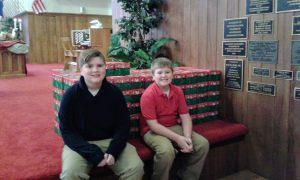 Youth members with Christmas shoe boxes